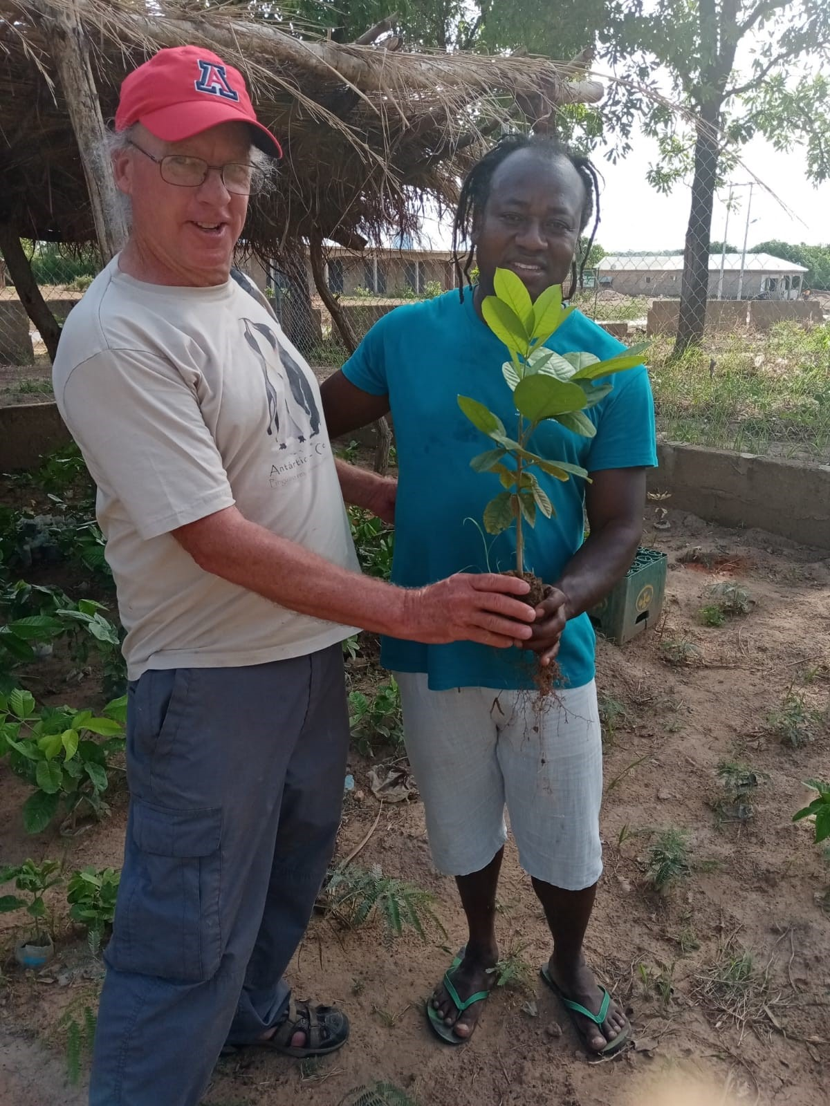 Peter and Rashid with seedling ready for transplanting